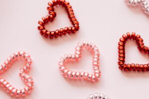red and pink hearts on a pink background
